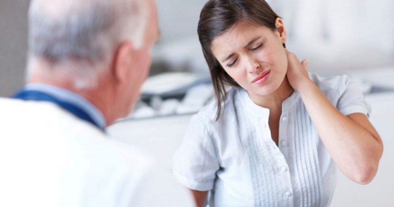 Woman in a chiropractic clinic because of neck pain