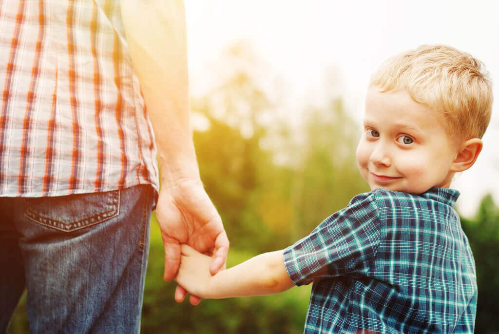 Chiropractor Perth - Kid holding parent's hand going to Perth Chiropractic Care for Kids clinic