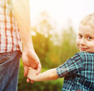 Kid holding parent's hand going to Perth Chiropractic Care for Kids clinic